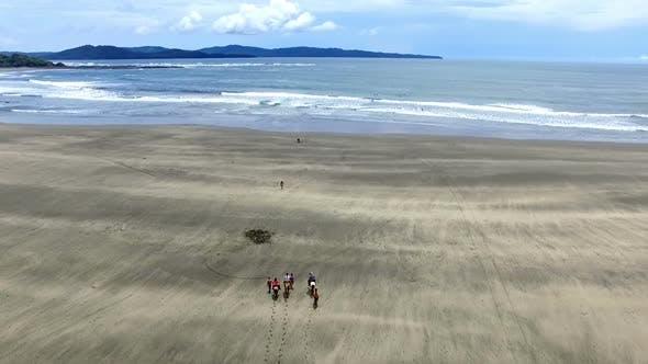 Thumbnail for Family Riding Horses on the Seashore