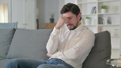 Disappointed Man Feeling Worried at Home