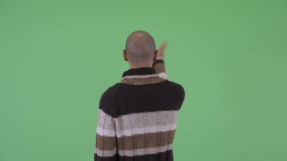 Thumbnail for Rear View of Bald Multi Ethnic Man Touching Something Ready for Winter