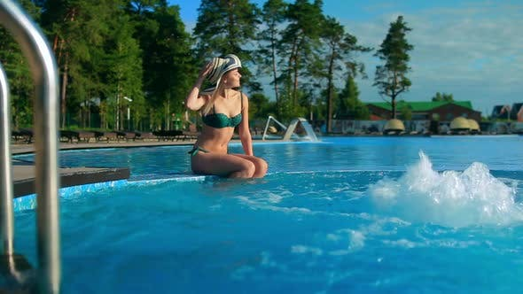 Thumbnail for Girl sitting on the side of the pool Jacuzzi