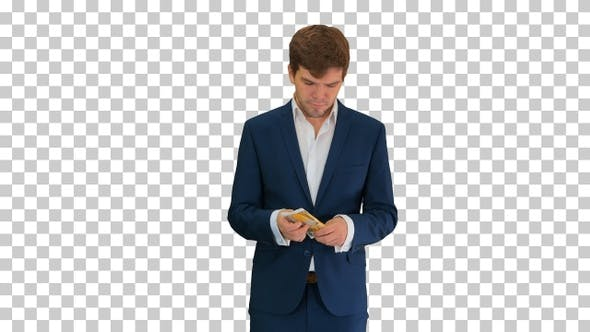 Happy businessman counting money and tucking, Alpha Channel