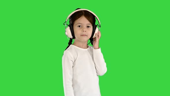 Thumbnail for Little Girl Dressed in White Listening To the Music in Headphones and Nodding Her Head To the Rhythm