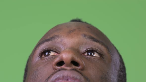 Thumbnail for Close Up Shot of Young African Man Thinking While Looking Up