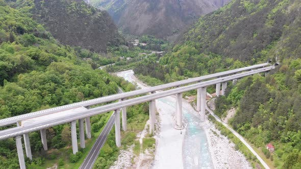 Thumbnail for Aerial View of the Concrete Highway Viaduct on Concrete Pillars in the Mountains