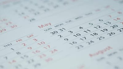 Close Up of White Color Calendar on Table,