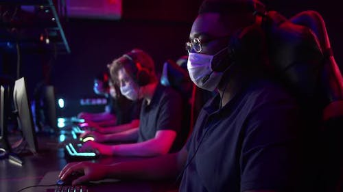 During the Coronavirus Pandemic an Esports Team Holds Masked Training Camps in a Computer Club