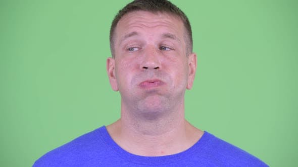 Thumbnail for Face of Stressed Macho Mature Man Looking Bored and Tired