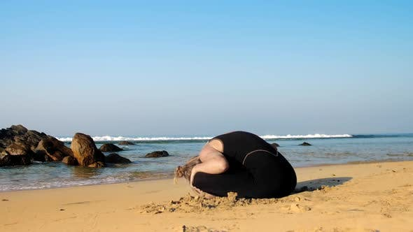 Thumbnail for Young Woman Practices Yoga Stretching Back and Neck