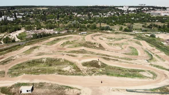 Aerial view of motorbike dirty racing track. Motocross motorcycle training track.