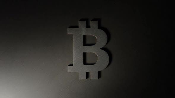 Thumbnail for Moving Light Illuminates Bitcoin Symbol