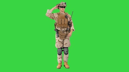 Military Soldier in Uniform Salutes on a Green Screen, Chroma Key.