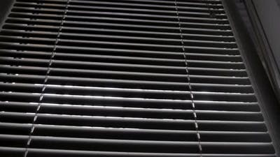 Blinds on a Window in a Dark Room Against the Light