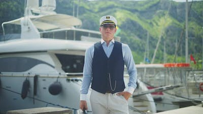 Captain standing in front of yacht