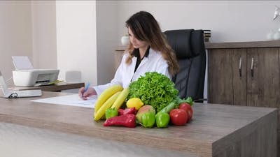 Doctor nutritionist working on a diet plan