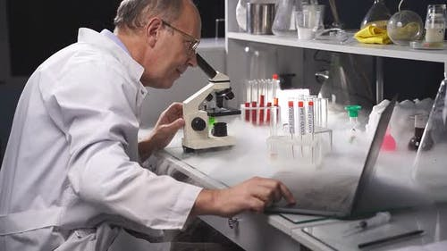 High Level Laboratory Scientist Examining Samples Test Tubes