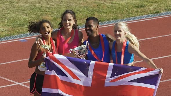 Cover Image for Cheerful young athletes are happy and proud about victory in championship