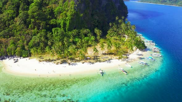 Thumbnail for Tourist Boats and Swiming People on the Amazing Nature Pinagbuyutan Island and Azure Sea of El Nido