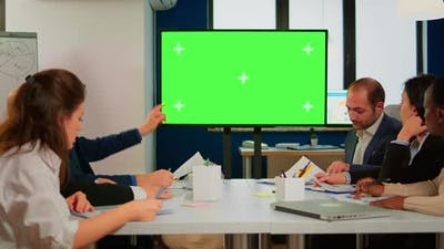 Group of Business People Discussing Company Plan with Mockup Tv Green Screen