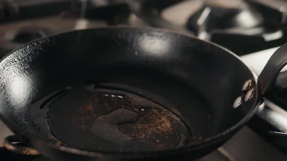 Thumbnail for Pour Oil on Frying Pan on Electric Stove. Pour Oil on Frying Pan on Cafe Stove
