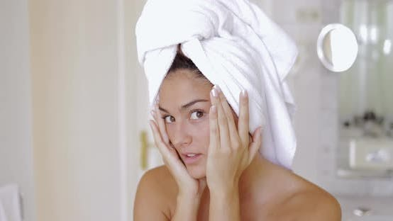 Thumbnail for Headshot of Young Pretty Woman with Towel on Head Looking at Camera