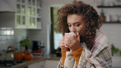Young woman having flu and taking medicine