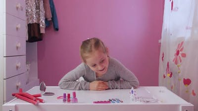 Little Girl And Cosmetics