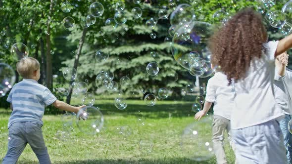 Thumbnail for Playful Kids Catching Soap Bubbles