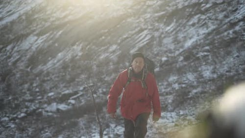 Hiker Walking Up Snowy Mountain Foothill