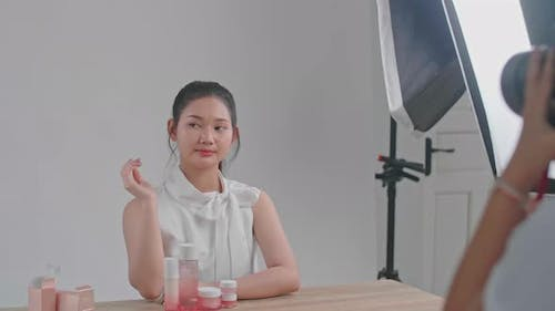 Behind The Scenes On Photo Shoot: Beautiful Asian Model Poses For A Photographer