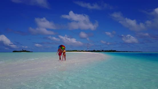 Thumbnail for Young couple on honeymoon vacation spend quality time on beach on paradise white sand background 4K
