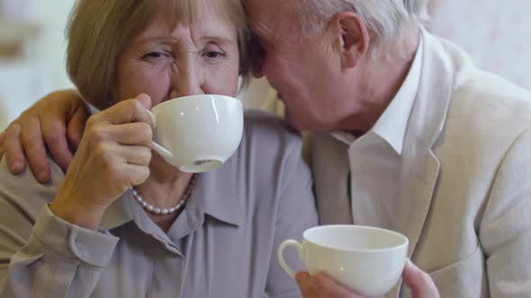 Thumbnail for Loving Elderly Couple Having Coffee