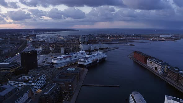 Thumbnail for Nordhavn Cruise Ship Docked in Copenhagen Pier and an Aerial View of the City