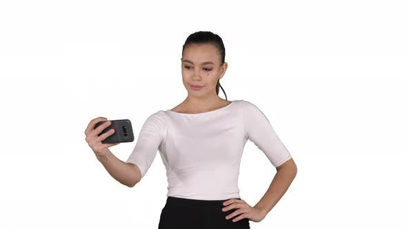 Thumbnail for Smiling Attractive Woman Taking a Selfie While Walking on White Background.