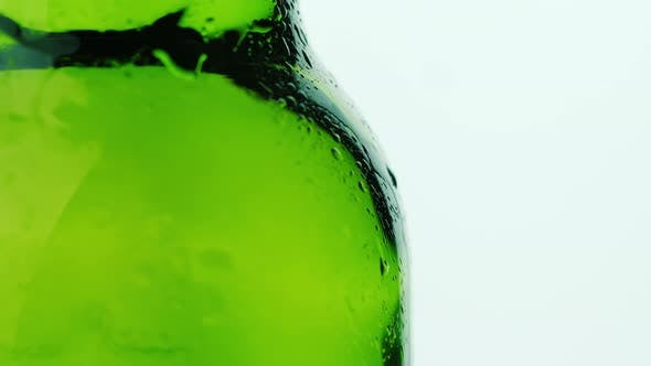 Thumbnail for Part of the Glass Beverage Bottle, Drops of Condensate Drain Down. On a White Background. Cool
