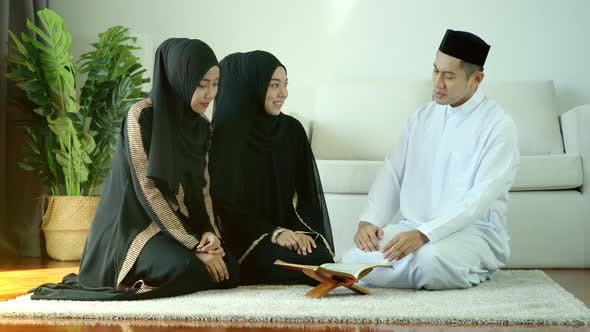 Asian Muslim Family Praying at Home