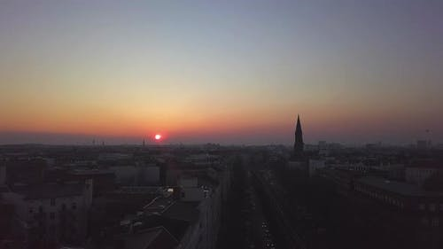 AERIAL: Over Berlin City Train Tracks with Sunset