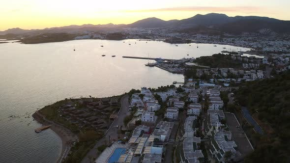 Thumbnail for Aerial Footage of Bodrum (Halicarnassus) Bay with White Houses at the Sunset