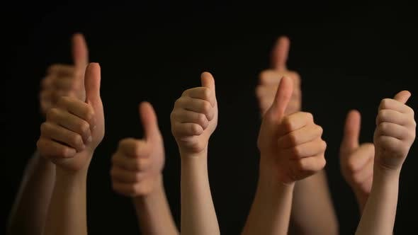 Thumbnail for Raising Hands with Thumbs Up on Black Background
