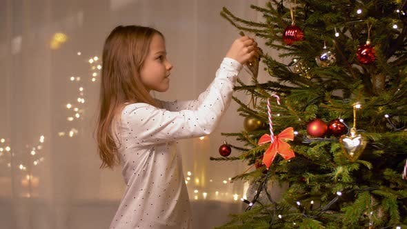 Thumbnail for Happy Girl Decorating Christmas Tree at Home 3