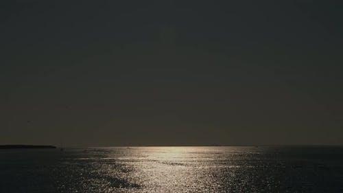 Sun glaring on the water surface