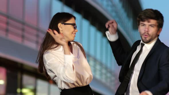Thumbnail for Business Couple Dancing By Office Building