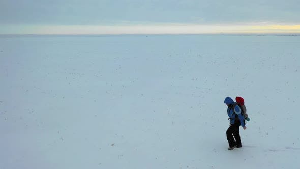 Thumbnail for Man with Red Backpack Walking By the Tundra. Strength, Overcoming and Tough Travel Concept.