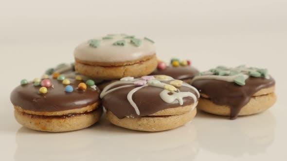 Cookies with sprinkles on pile slow tilt 4K 2160p 30fps UltraHD footage - Stuffed teacakes close-up