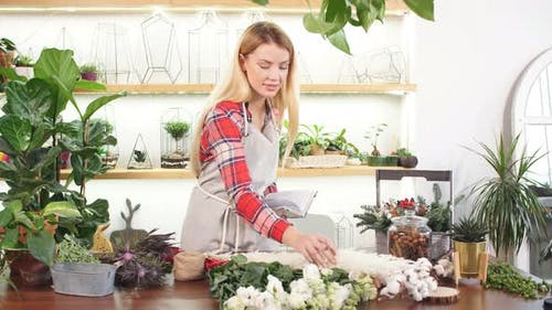 Young Florist Lady with Notebook