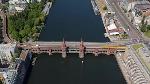 Aerial View of U Bahn Train Crossing Historic Oberbaum Bridge