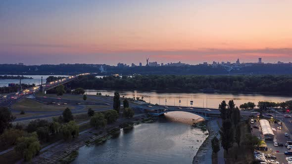 Timelapse of Evening Kiev. View of the Right Bank, Paton Bridge and Motherland. Aerial Hyperlapse