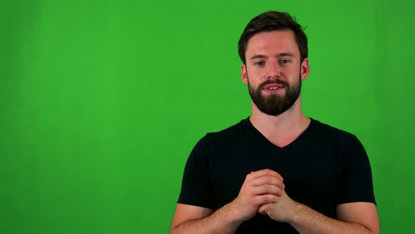 Thumbnail for Young Handsome Bearded Man Talks To Camera - Green Screen - Studio