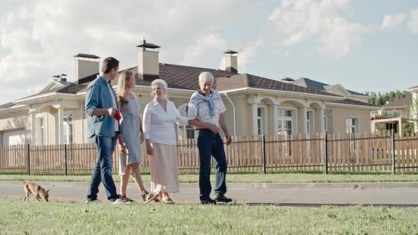 Thumbnail for Young Family Walking with Elderly Couple