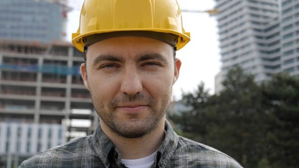 Thumbnail for Young Businessman Construction Site Engineer Looking to Camera.
