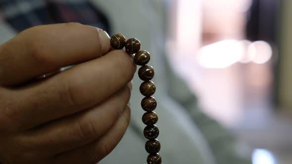 Thumbnail for Man Prays the Rosary